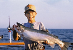Young kid with salmon